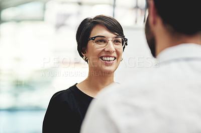 Buy stock photo Cropped shot of a businesswoman having a discussion with a colleague in an office