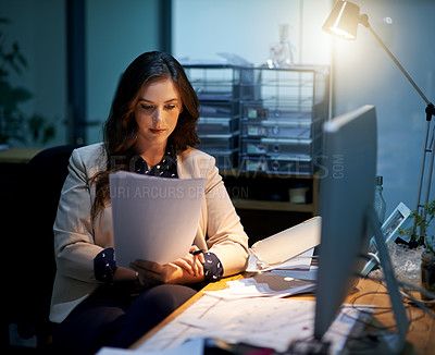 Buy stock photo Cropped shot of a young businesswoman working late in an office