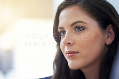Buy stock photo Closeup shot of a young woman looking away