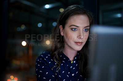 Buy stock photo Cropped shot of a young businesswoman working late on a computer in an office