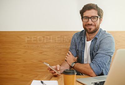 Buy stock photo Cropped portrait of a young man sending a text message while working on his laptop