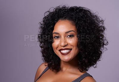 Buy stock photo Cropped shot of a beautiful woman with curly hair posing in the studio