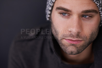 Buy stock photo Cropped shot of a stylish young man posing in the studio