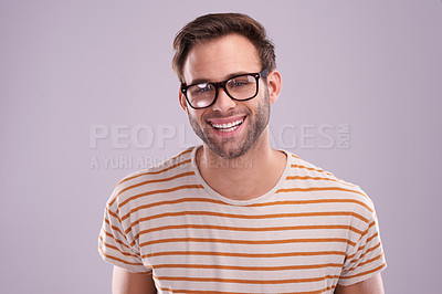 Buy stock photo Studio portrait of a happy young man posing against a lilac background