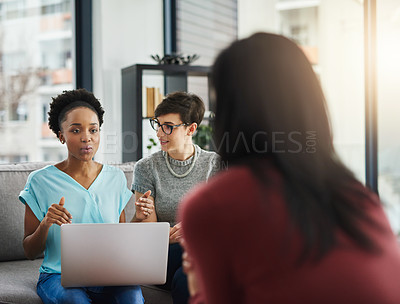 Buy stock photo Shot of businesspeople having a discussion in the office
