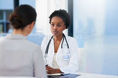 Buy stock photo Cropped shot of a female doctor talking to a patient in her office