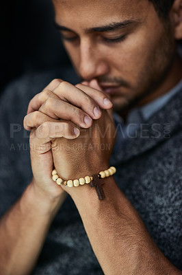 Buy stock photo Closeup shot of a young man praying with his eyes closed