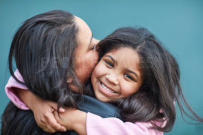 Buy stock photo Cropped portrait of a cute little girl hugging her mother