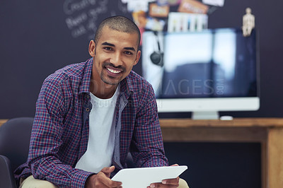 Buy stock photo Cropped portrait of a young designer working on his tablet in the office