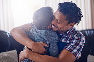 Buy stock photo Cropped shot of a father and son spending some quality time together at home