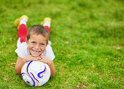 Buy stock photo Portrait of a young boy playing soccer outside
