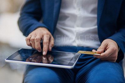 Buy stock photo Shot of an unrecognizable businessman using his digital tablet