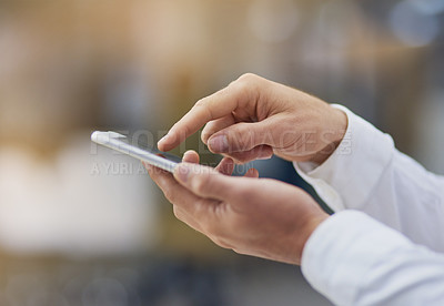 Buy stock photo Shot of an unrecognizable businessman using his cellphone