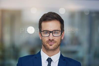 Buy stock photo Portrait of a young businessman standing in his office