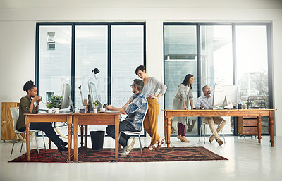 Buy stock photo Shot of a group of creatives working in a modern office