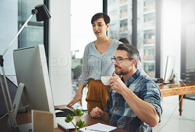 Buy stock photo Cropped of colleagues working together on a computer in a modern office
