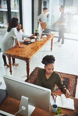 Buy stock photo Cropped shot of a group of creatives working in a modern office