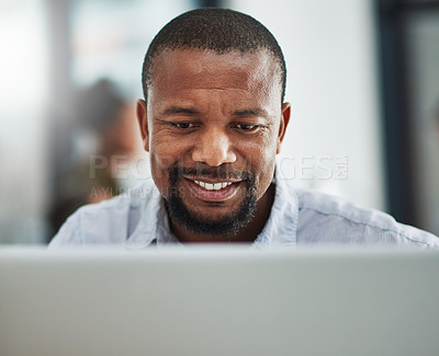 Buy stock photo Cropped shot of a mature businessman working on a computer in an office