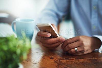 Buy stock photo Closeup shot of a businessman texting on a cellphone at work