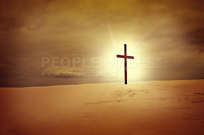 Buy stock photo Shot of an empty cross standing on a bare landscape