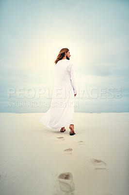 Buy stock photo Shot of Jesus walking in a sandy landscape