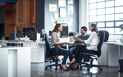 Buy stock photo Full length shot of three colleagues working in the office