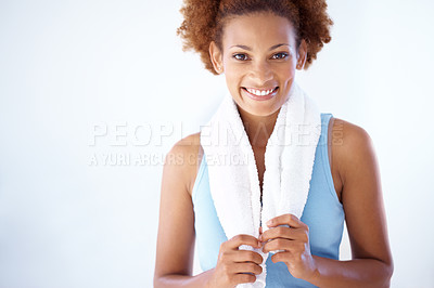 Buy stock photo Portrait of a smiling cute lady holding a towel around neck after a workout at gym