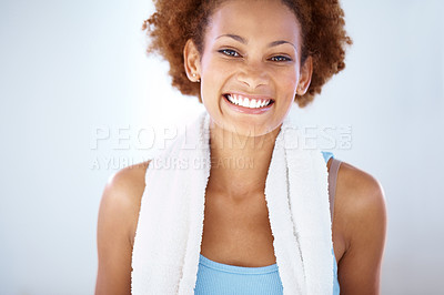 Buy stock photo Portrait of a happy young woman smiling radiantly with a towel around her neck - copyspace