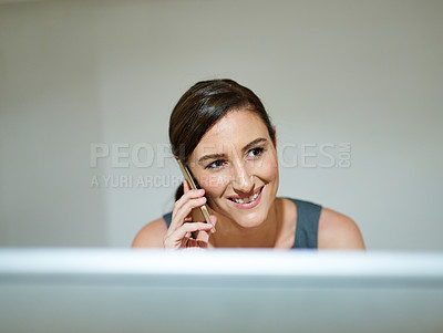 Buy stock photo Shot of a professional businesswoman using a phone in her office