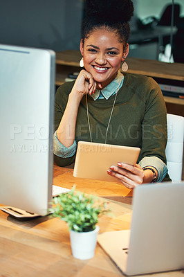 Buy stock photo Portrait of an attractive young woman working on her tablet in the office