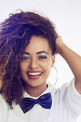 Buy stock photo Cropped shot of a woman wearing a white shirt and a bow-tie against a white background