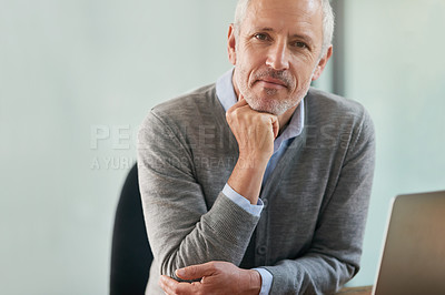 Buy stock photo Portrait of a mature businessman looking thoughtful while sitting in his office