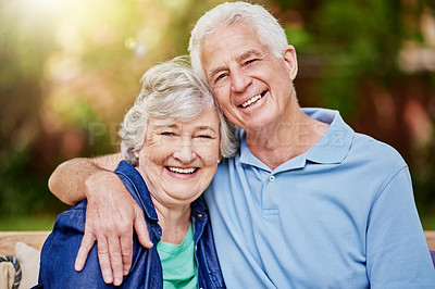 Buy stock photo Cropped portrait of an affectionate senior couple sitting in their backyard