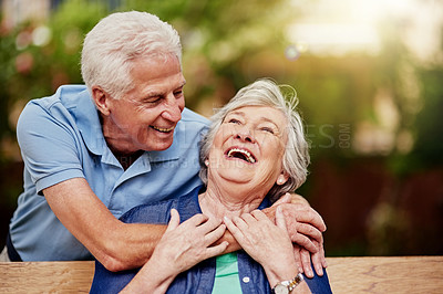 Buy stock photo Cropped shot of an affectionate senior couple laughing in their backyard