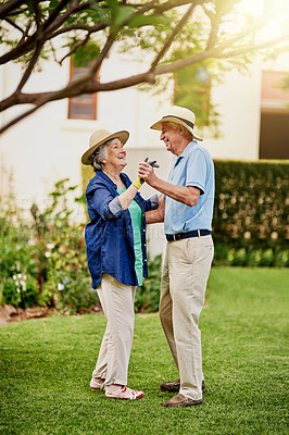 Buy stock photo Full length shot of an affectionate senior couple dancing in their backyard
