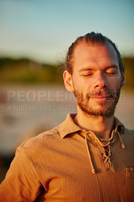 Buy stock photo Shot of a man enjoying a peaceful moment at the beach