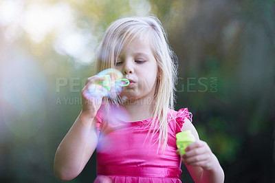 Buy stock photo Cropped shot of a cute little girl playing outside