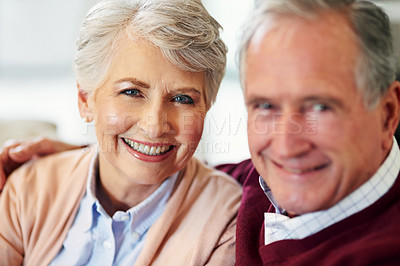 Buy stock photo Portrait of a senior couple sitting together at home