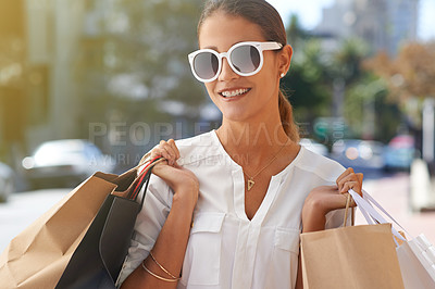 Buy stock photo Portrait of a happy young woman on a shopping spree in the city
