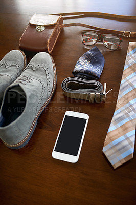 Buy stock photo High angle shot of a stylish business outfit and accessories laid out on a table