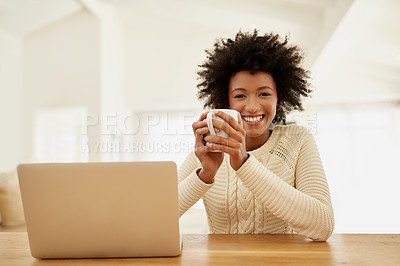 Buy stock photo Portrait of an attractive young using her laptop and drinking some coffee at home