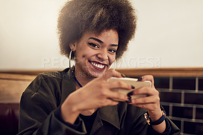 Buy stock photo Portrait of a beautiful young woman using her cellphone in a cafe