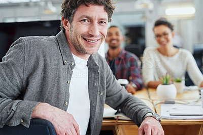 Buy stock photo Portrait of a group of designers sitting at their workstations in an office