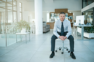 Buy stock photo Portrait of a man sitting on a chair in an office