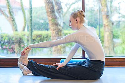 Buy stock photo Shot of a young woman practising ballet