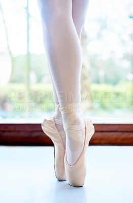 Buy stock photo Cropped shot of a ballet dancer standing on tiptoes