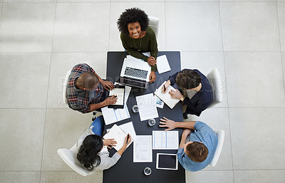 Buy stock photo High angle portrait of a team of colleagues having a meeting in a office