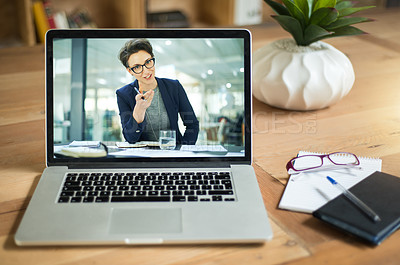 Buy stock photo Shot of a businesswoman having a video call on a laptop