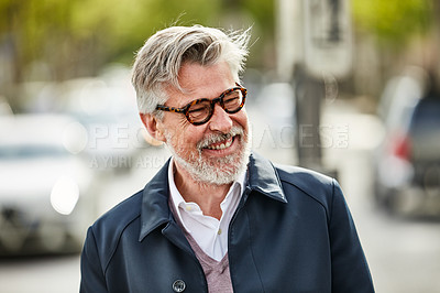 Buy stock photo Shot of a stylish mature man enjoying a day in the city