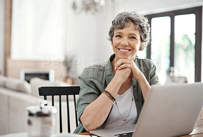 Buy stock photo Portrait of a mature woman working on her laptop at home